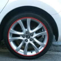 Close Up Of Mazda With Silver Alloy Wheels And Red AlloyGator Wheel Protection