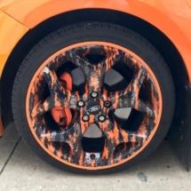 Orange Ford with custom Orange and Black Alloy wheel with Orange AlloyGator alloy wheel rim protectors