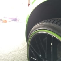 Close Up View Of Green Ford GT With Original Green AlloyGator Alloy Wheel Protectors