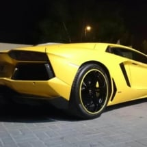 Rear View Of A Yellow Lamborghini With Black Alloy Wheels And Yellow AlloyGator Alloy Wheel Protectors