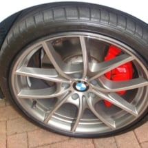 Close Up Of Silver BMW Alloy Wheel With Black AlloyGator Wheel Protection & Red Brake Callipers