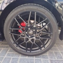 Close Up Of Ford With Black AlloyGator Wheel Rim Protectors And Red Brake Callipers