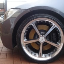 Close Up Of A BMW With Custom Silver Alloy Wheels And Black AlloyGator Wheel Protector