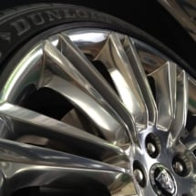 Close Up Of A Silver Jaguar Alloy Wheel With Black AlloyGator Alloy Wheel Protector