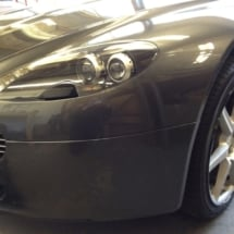 Front View Of Silver Aston Martin With Silver Alloy Wheels And Black AlloyGator Wheel Protection