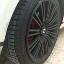 Close Up Of Rear Black Bentley Alloy Wheel With Black AlloyGator Wheel Rim Protector
