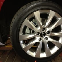 Close Up Of Red Hyundai With Silver Alloy Wheels And Black AlloyGator Alloy Wheel Protector