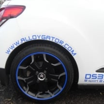 Close Up Of A White Citroen With Dimond Cut Black Alloy Wheels With Blue AlloyGator Alloy Wheel Rim Protector