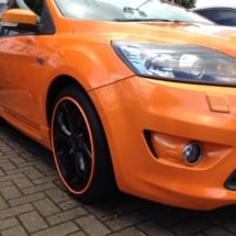 Front View Of Orange Ford With Black Alloy Wheels And Orange AlloyGator Wheel Protection