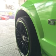 Front View Of Green Ford GT With Original Green AlloyGator Alloy Wheel Protectors