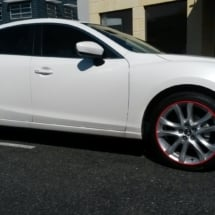 Side View Of Mazda With Silver Alloy Wheels And Red AlloyGator Alloy Wheel Protection