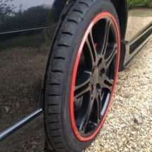 Close Up View Of Honda Civic Type R Black Alloy Wheels With Red AlloyGator Alloy Wheel Protector