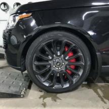 Black Land Rover with Black AlloyGators