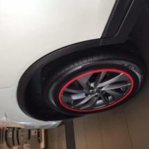 White Mazda with Red AlloyGators