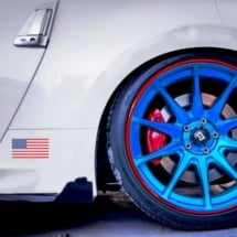 White Car with Blue Alloy Wheels and Red AlloyGators