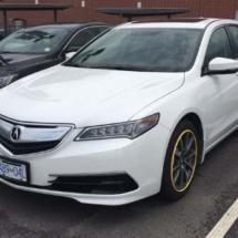 White Acura with Yellow AlloyGators