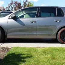 Silver VW Golf with Red AlloyGators
